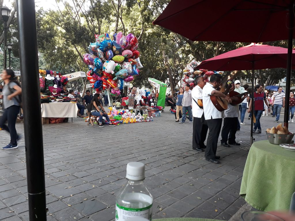 guitar players serenading a table in Zocalo